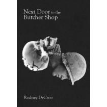 Next Door to the Butcher Shop by Rodney DeCroo, 9780889713307